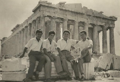Dad and fellow refugees sitting in front of the Parthenon in 1956